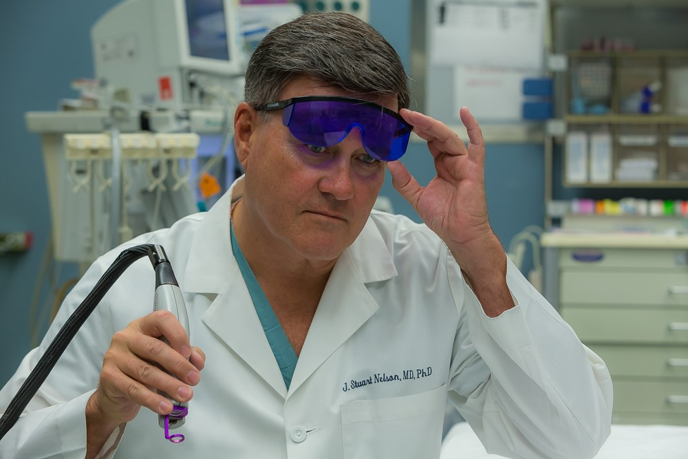 Dr. J. Stuart Nelson performing laser treatment